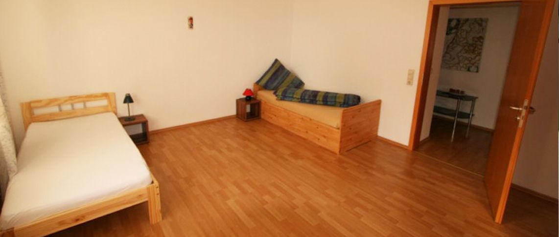 אחד מהחדרים ב-דירת נופש 5 חדרים